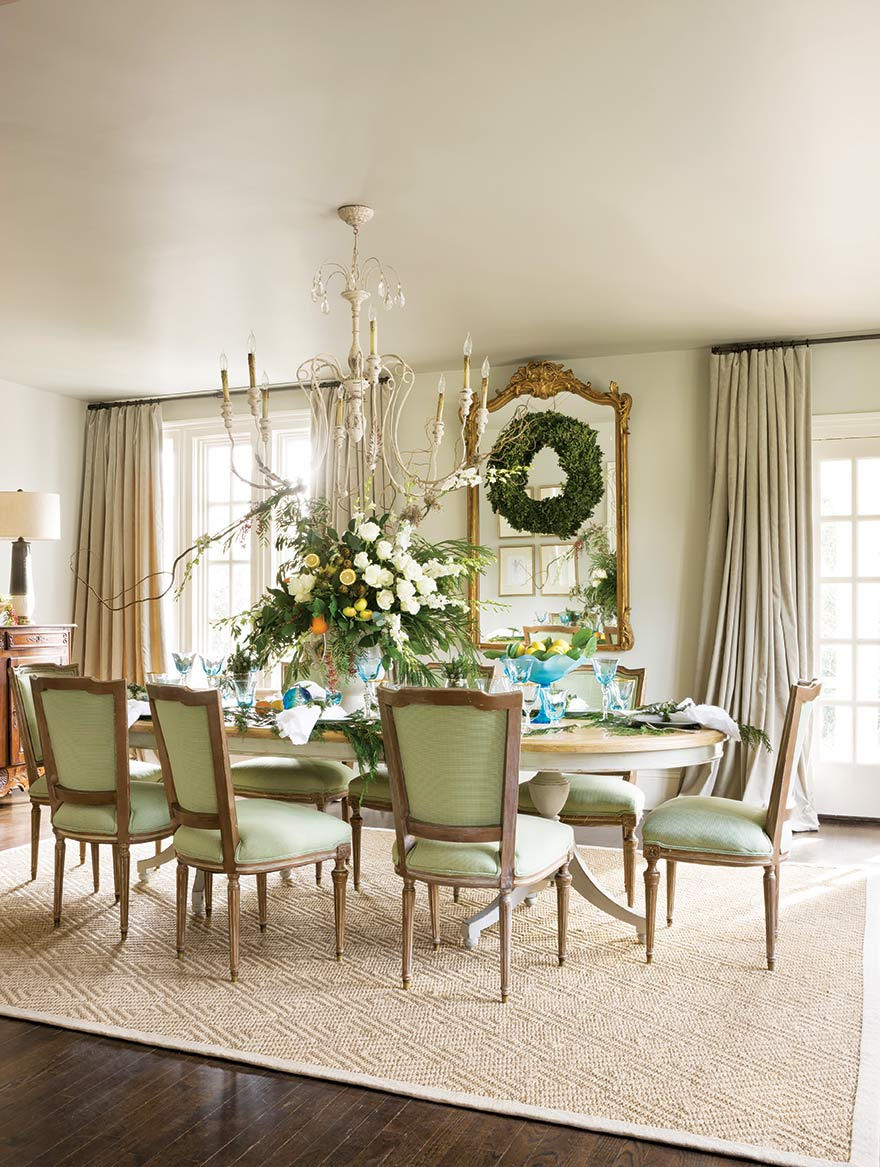 A gilded mirror tilts slightly down to reflect the decadence of the holiday table.