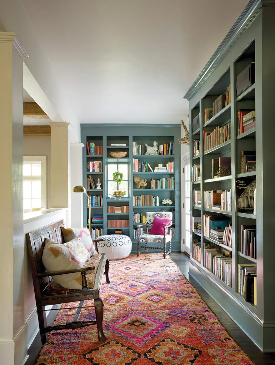 A colourful rug and pillows add warmth to this cozy library.