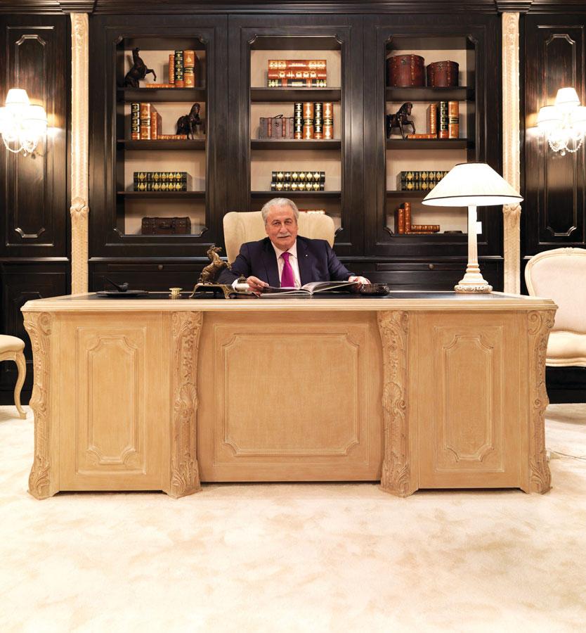 Guido Savio in front of a desk