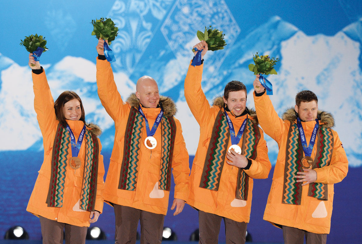 Martins Rubenis standing on the Olympic medal podium