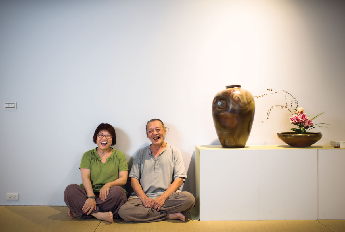 Ash Glaze Master, Chengtai Tian, at his home with his wife