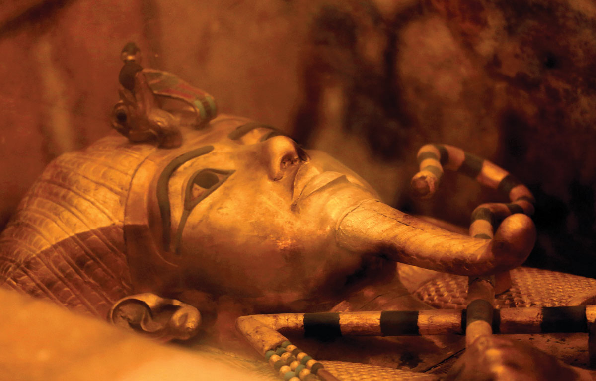 An extravagant gold sarcophagus protects the mummy of its king.