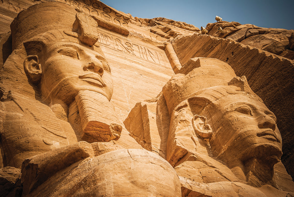 30-metre-tall statues of Ramses II and Nefertari adorn the façade of the large temple at Abu Simbel.