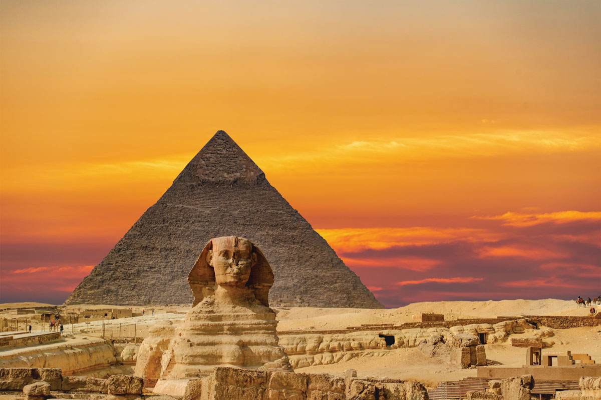 The Great Sphinx sits in front of the temples at Giza.