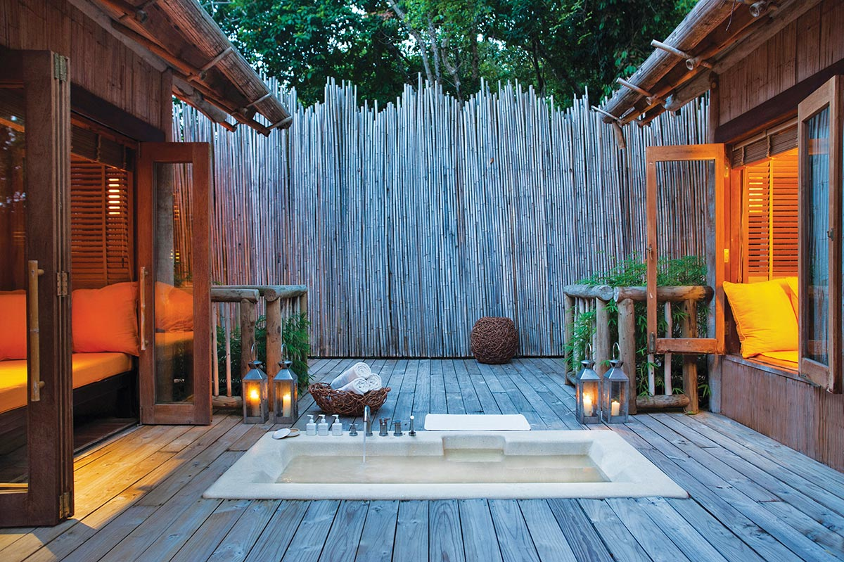 Many of the villas feature outdoor bathrooms, like this private-yet-open example from Soneva Kiri.