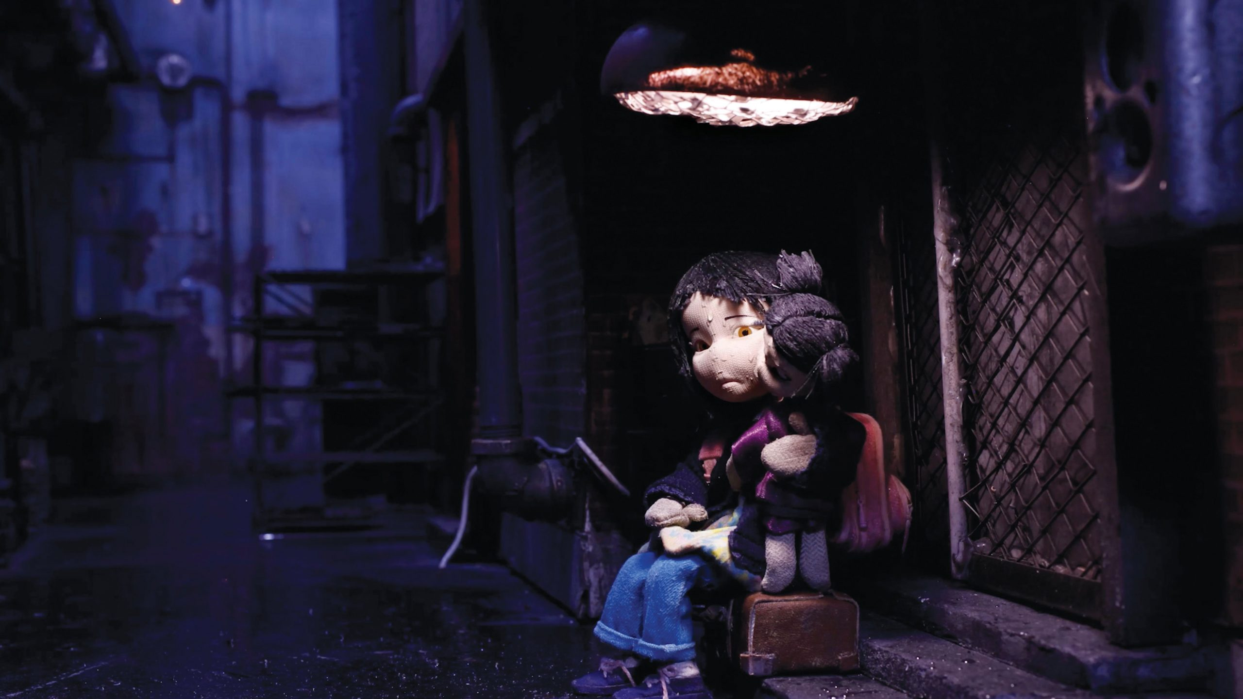 Rag-Doll-Still-01_Yingying-sits-in-dark-with-her-doll